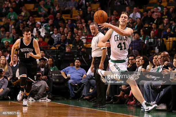 Kelly Olynyk of the Boston Celtics jumps to save the ball from going out of bounds against the Brooklyn Nets during a preseason game at TD Garden on...