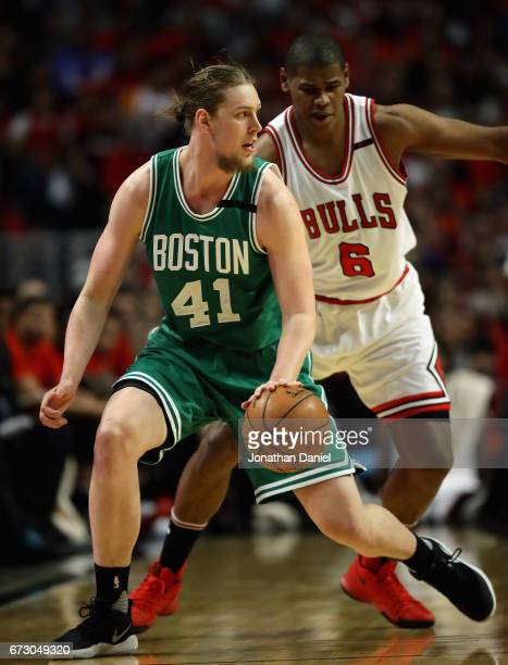 Kelly Olynyk of the Boston Celtics moves against Cristiano Felicio of the Chicago Bulls during Game Four of the Eastern Conference Quarterfinals...