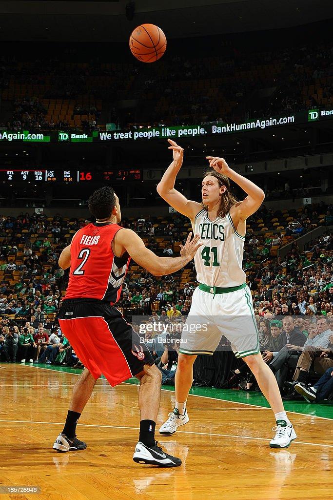 Kelly Olynyk #41 of the Boston Celtics passes the ball against the Toronto Raptors on October 7, 2013 at the TD Garden in Boston, Massachusetts.