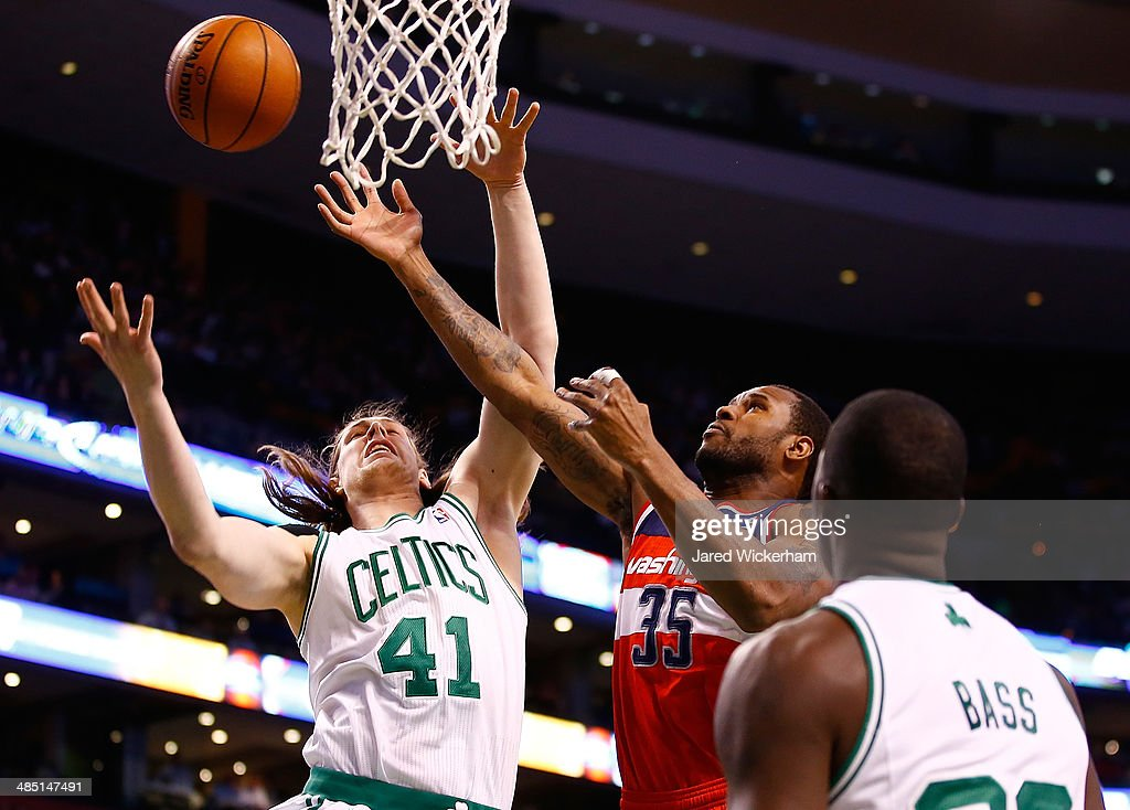 Kelly Olynyk #41 of the Boston Celtics reaches for a loose ball rebound in front of Trevor Booker #35 of the Washington Wizards in the first quarter during the game at TD Garden on April 16, 2014 in Boston, Massachusetts.