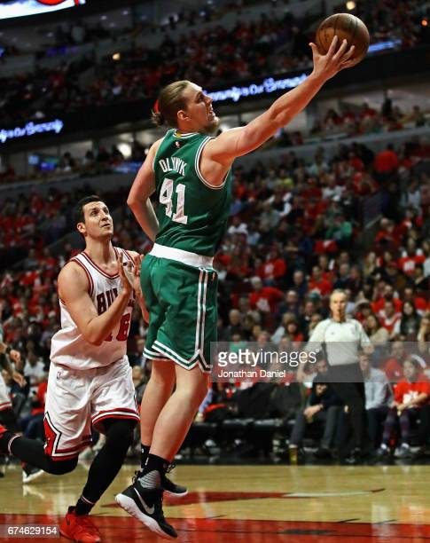 Kelly Olynyk of the Boston Celtics reaches for a rebound in front of Paul Zipser of the Chicago Bulls during Game Six of the Eastern Conference...