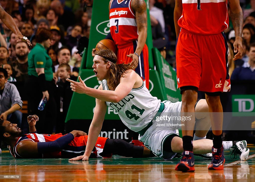 <a gi-track='captionPersonalityLinkClicked' href=/galleries/search?phrase=Kelly+Olynyk&family=editorial&specificpeople=5953512 ng-click='$event.stopPropagation()'>Kelly Olynyk</a> #41 of the Boston Celtics reacts after being called for a foul in front of <a gi-track='captionPersonalityLinkClicked' href=/galleries/search?phrase=John+Wall&family=editorial&specificpeople=2265812 ng-click='$event.stopPropagation()'>John Wall</a> #2 of the Washington Wizards in the second half during the game at TD Garden on April 16, 2014 in Boston, Massachusetts.