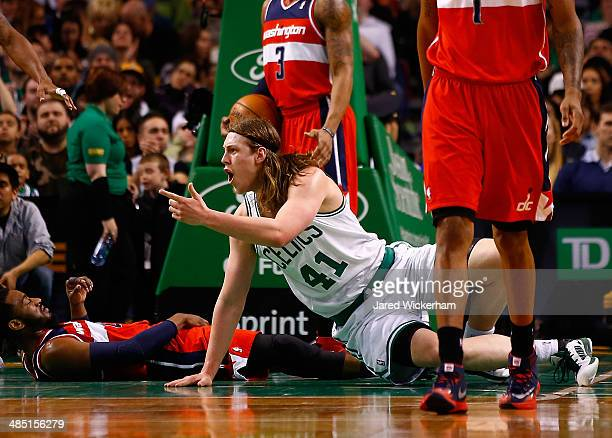 Kelly Olynyk of the Boston Celtics reacts after being called for a foul in front of John Wall of the Washington Wizards in the second half during the...