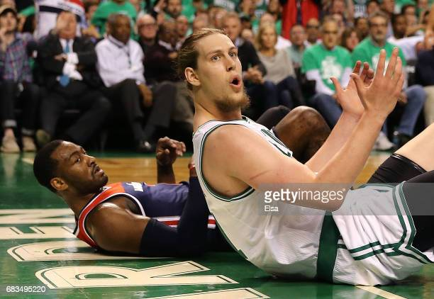Kelly Olynyk of the Boston Celtics reacts after defending against John Wall of the Washington Wizards during Game Seven of the NBA Eastern Conference...