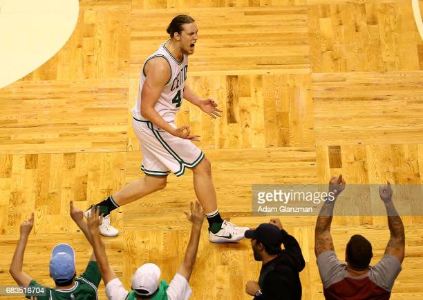 Kelly Olynyk of the Boston Celtics reacts against the Washington Wizards during Game Seven of the NBA Eastern Conference SemiFinals at TD Garden on...