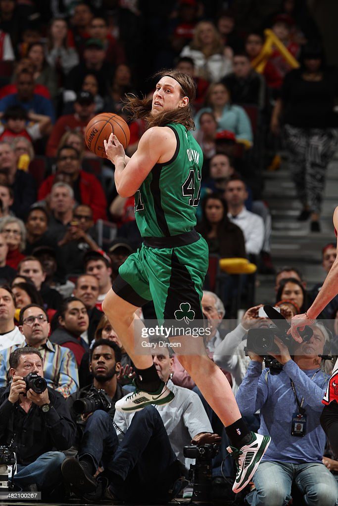 Kelly Olynyk #41 of the Boston Celtics saves the ball during the game against the Chicago Bulls on March 31, 2014 at the United Center in Chicago, Illinois.