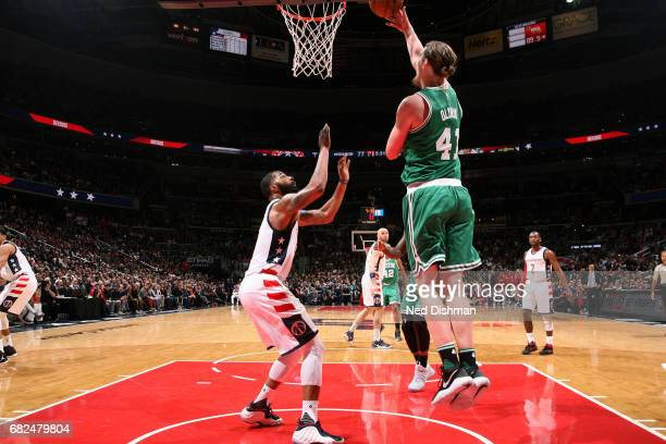 Kelly Olynyk of the Boston Celtics shoots a lay up during the game against the Washington Wizards during Game Six of the Eastern Conference...