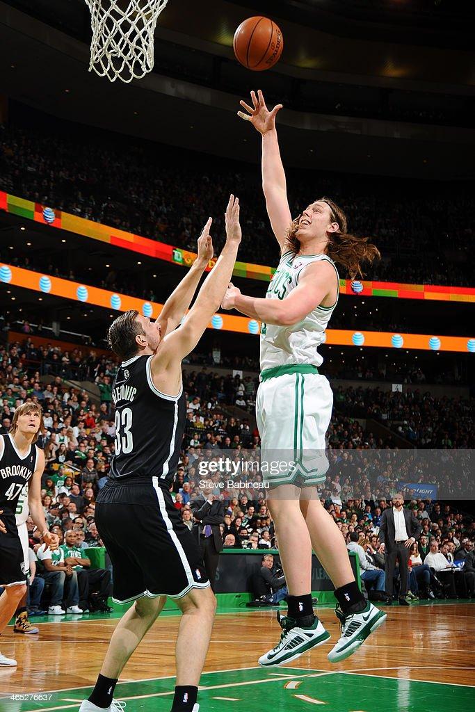 Kelly Olynyk #41 of the Boston Celtics shoots against Mirza Teletovic #33 of the Brooklyn Nets on January 26, 2014 at the TD Garden in Boston, Massachusetts.