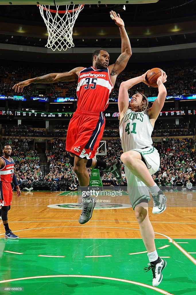 Kelly Olynyk #41 of the Boston Celtics shoots against the Washington Wizards on April 16, 2014 at the TD Garden in Boston, Massachusetts.