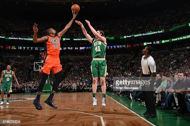 Kelly Olynyk of the Boston Celtics shoots the ball against the Oklahoma City Thunder on March 16 2016 at the TD Garden in Boston Massachusetts NOTE...