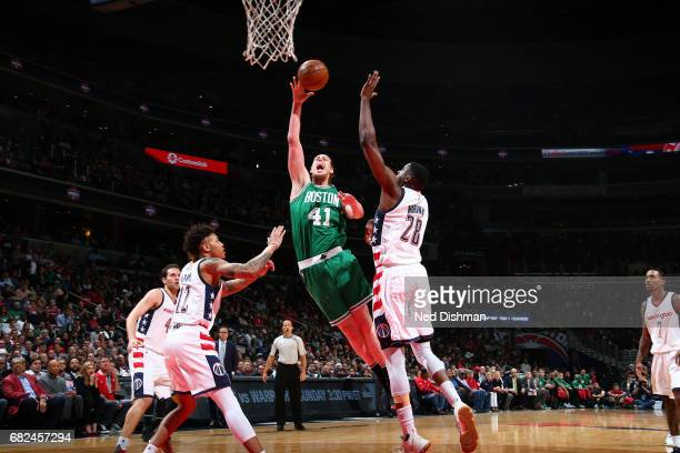 Kelly Olynyk of the Boston Celtics shoots the ball during the game against the Washington Wizards during Game Six of the Eastern Conference...