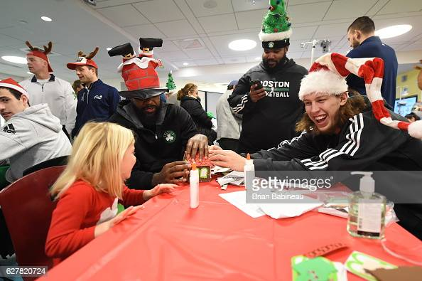 Kelly Olynyk of the Boston Celtics spreads holiday cheer duing a children's hospital visit on December 1 2016 at Boston Children's Hospital in Boston...