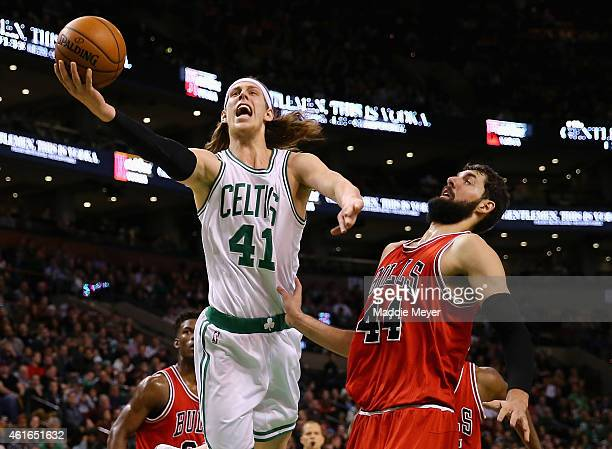 Kelly Olynyk of the Boston Celtics takes a shot over Nikola Mirotic of the Chicago Bulls during the third quarter at TD Garden on January 16 2015 in...