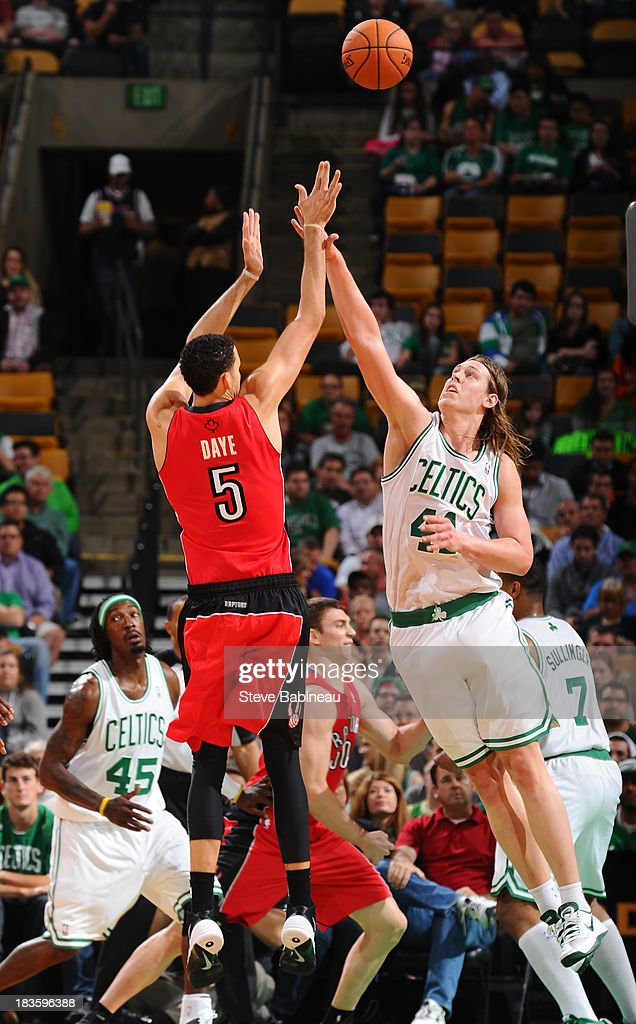 Kelly Olynyk #41 of the Boston Celtics tries to block the shot against Austin Daye #5 of the Toronto Raptors on October 7, 2013 at the TD Garden in Boston, Massachusetts.