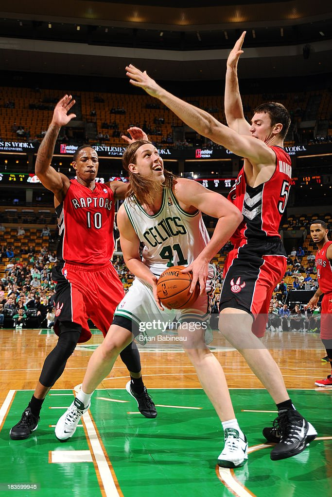 Kelly Olynyk #41 of the Boston Celtics with the ball against the Toronto Raptors on October 7, 2013 at the TD Garden in Boston, Massachusetts.