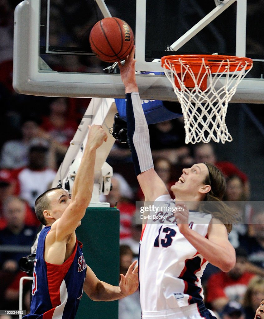 Kelly Olynyk #13 of the Gonzaga Bulldogs blocks a shot by Beau Levesque #15 of the Saint Mary's Gaels during the championship game of the West Coast Conference Basketball tournament at the Orleans Arena March 11, 2013 in Las Vegas, Nevada. Gonzaga won 65-51.