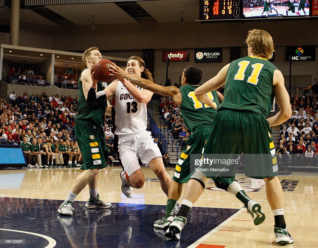 Kelly Olynyk #13 of the Gonzaga Bulldogs drives to the hoop during the second half of the game against the San Francisco Dons at McCarthey Athletic Center on January 26, 2013 in Spokane, Washington.