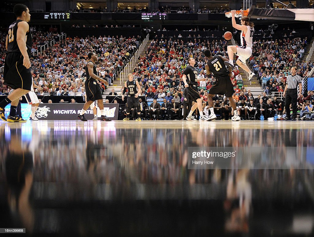 Kelly Olynyk of the Gonzaga Bulldogs dunks the ball against Ehimen Orukpe of the Wichita State Shockers in the first half during the third round of...