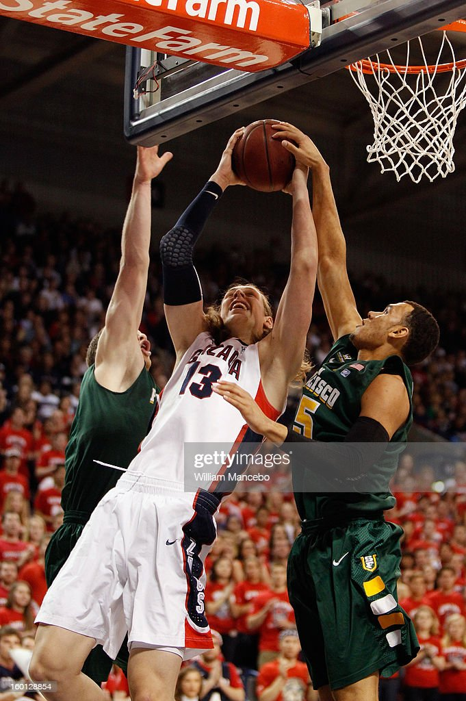 Kelly Olynyk #13 of the Gonzaga Bulldogs goes to the hoop with forward Cole Dickerson #25 of the San Francisco Dons defending during the first half of the game at McCarthey Athletic Center on January 26, 2013 in Spokane, Washington.