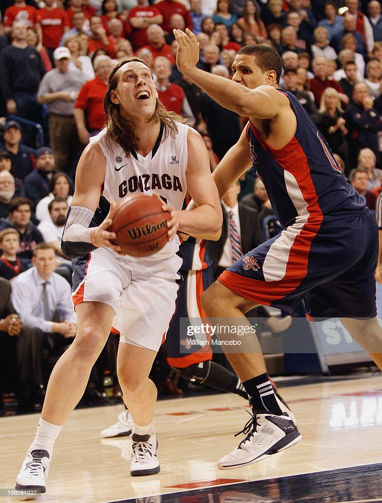 Kelly Olynyk #13 of the Gonzaga Bulldogs goes up for a goal against Brad Waldow #00 of the Saint Mary's Gaels at McCarthey Athletic Center on January 10, 2013 in Spokane, Washington.