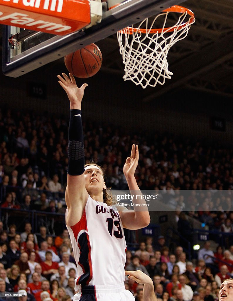 Kelly Olynyk #13 of the Gonzaga Bulldogs goes up for a goal during the game against the BYU Cougars at McCarthey Athletic Center on January 24, 2013 in Spokane, Washington.