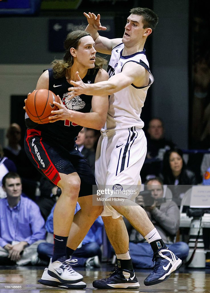 Kelly Olynyk #13 of the Gonzaga Bulldogs holds the ball as <a gi-track='captionPersonalityLinkClicked' href=/galleries/search?phrase=Andrew+Smith+-+Basketball+Player&family=editorial&specificpeople=7641849 ng-click='$event.stopPropagation()'>Andrew Smith</a> #44 of the Butler Bulldogs defends at Hinkle Fieldhouse on January 19, 2013 in Indianapolis, Indiana. Butler defeated Gonzaga 64-63.