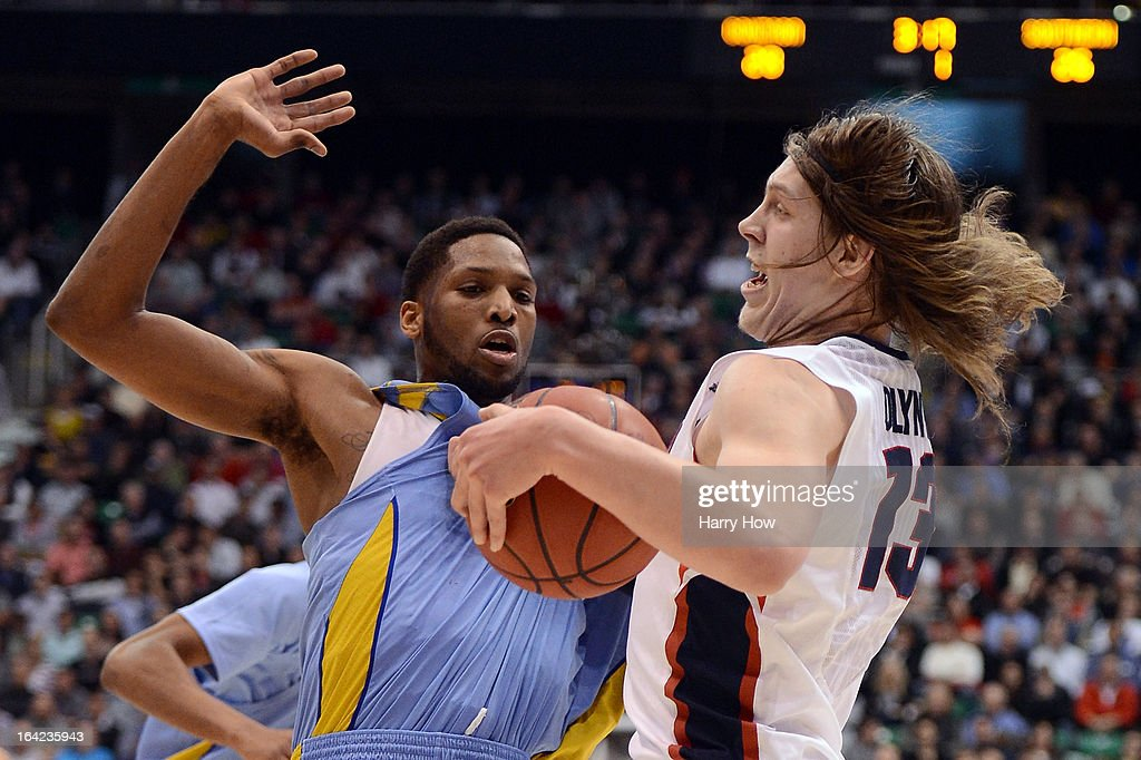 <a gi-track='captionPersonalityLinkClicked' href=/galleries/search?phrase=Kelly+Olynyk&family=editorial&specificpeople=5953512 ng-click='$event.stopPropagation()'>Kelly Olynyk</a> #13 of the Gonzaga Bulldogs with the ball against <a gi-track='captionPersonalityLinkClicked' href=/galleries/search?phrase=Brandon+Moore&family=editorial&specificpeople=241545 ng-click='$event.stopPropagation()'>Brandon Moore</a> #32 of the Southern University Jaguars in the first half during the second round of the 2013 NCAA Men's Basketball Tournament at EnergySolutions Arena on March 21, 2013 in Salt Lake City, Utah.