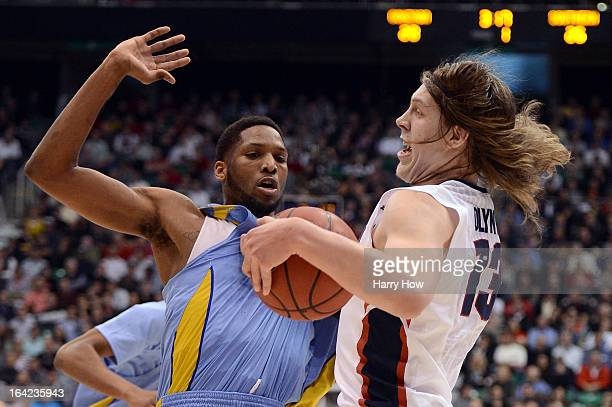 Kelly Olynyk of the Gonzaga Bulldogs with the ball against Brandon Moore of the Southern University Jaguars in the first half during the second round...