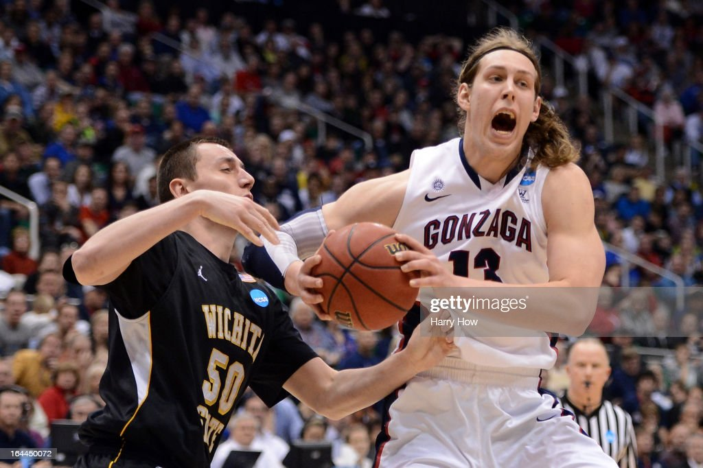 <a gi-track='captionPersonalityLinkClicked' href=/galleries/search?phrase=Kelly+Olynyk&family=editorial&specificpeople=5953512 ng-click='$event.stopPropagation()'>Kelly Olynyk</a> #13 of the Gonzaga Bulldogs with the ball against <a gi-track='captionPersonalityLinkClicked' href=/galleries/search?phrase=Jake+White&family=editorial&specificpeople=217357 ng-click='$event.stopPropagation()'>Jake White</a> #50 of the Wichita State Shockers in the second half during the third round of the 2013 NCAA Men's Basketball Tournament at EnergySolutions Arena on March 23, 2013 in Salt Lake City, Utah.