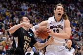 Kelly Olynyk of the Gonzaga Bulldogs with the ball against Jake White of the Wichita State Shockers in the second half during the third round of the...