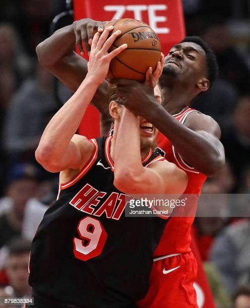 Kelly Olynyk of the Miami Heat and Bobby Portis of the Chicago Bulls battle for a rebound at the United Center on November 26 2017 in Chicago...