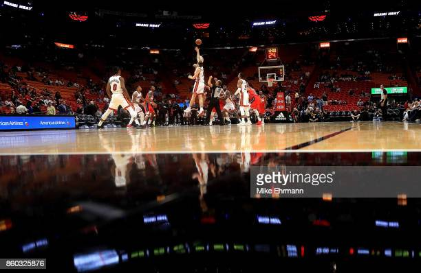 Kelly Olynyk of the Miami Heat and Marcin Gortat of the Washington Wizards jump ball during a preseason game at American Airlines Arena on October 11...