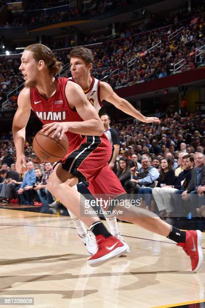 Kelly Olynyk of the Miami Heat handles the ball against the Cleveland Cavaliers on November 28 2017 at Quicken Loans Arena in Cleveland Ohio NOTE TO...