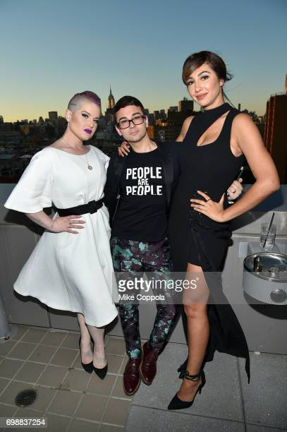 Kelly Osborne Christian Siriano and Jackie Cruz attend the amfAR generationCURE Solstice 2017 at Mr Purple on June 20 2017 in New York City