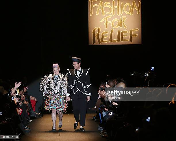 Kelly Osbourne and Brad Goreski walk the runway during Naomi Campbell's Fashion For Relief 2015 fall fashion show at The Theater at Lincoln Center on...
