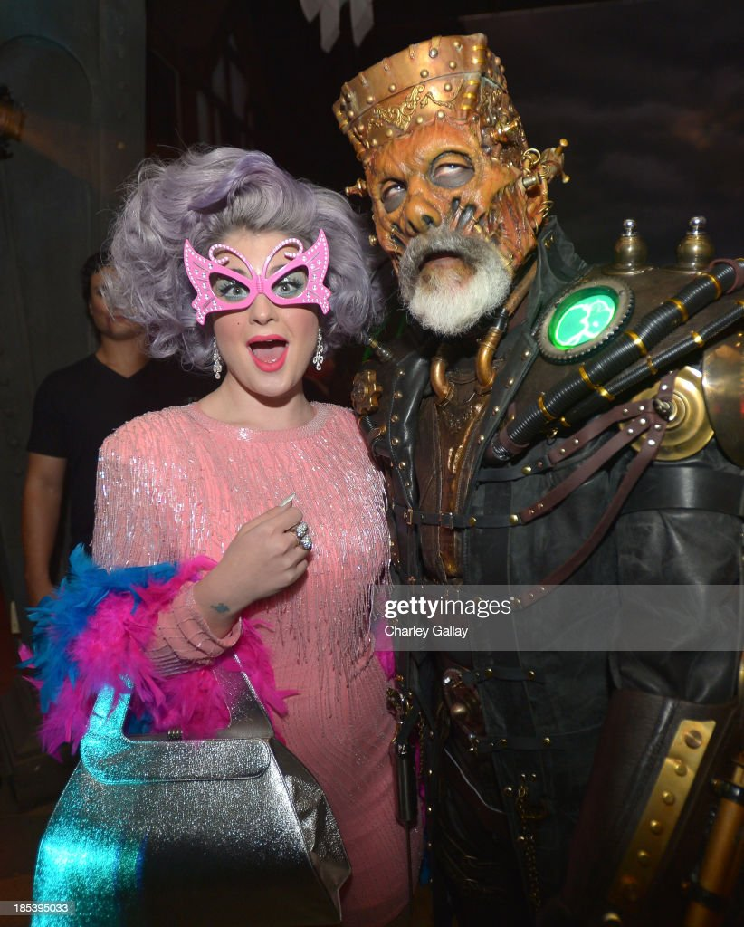 <a gi-track='captionPersonalityLinkClicked' href=/galleries/search?phrase=Kelly+Osbourne&family=editorial&specificpeople=156416 ng-click='$event.stopPropagation()'>Kelly Osbourne</a> and <a gi-track='captionPersonalityLinkClicked' href=/galleries/search?phrase=Rick+Baker&family=editorial&specificpeople=540260 ng-click='$event.stopPropagation()'>Rick Baker</a> attend MAC Cosmetics and <a gi-track='captionPersonalityLinkClicked' href=/galleries/search?phrase=Rick+Baker&family=editorial&specificpeople=540260 ng-click='$event.stopPropagation()'>Rick Baker</a>'s Monster Mash on October 19, 2013 in Glendale, California.