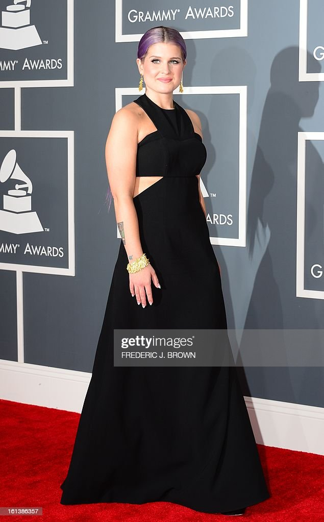 Kelly Osbourne arrives on the red carpet at the Staples Center for the 55th Grammy Awards in Los Angeles, California, February 10, 2013. AFP PHOTO Frederic J. BROWN