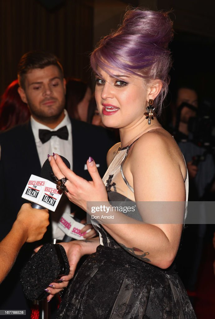 <a gi-track='captionPersonalityLinkClicked' href=/galleries/search?phrase=Kelly+Osbourne&family=editorial&specificpeople=156416 ng-click='$event.stopPropagation()'>Kelly Osbourne</a> is interviewed on the red carpet at the CLEO magazine relaunch party at The Star on April 30, 2013 in Sydney, Australia.