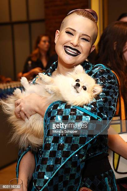 Kelly Osbourne poses for a photo with her dog Polly backstage at The Blonds fashion show during MADE Fashion Week September 2016 at Milk Studios on...