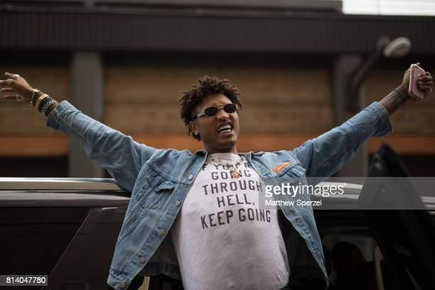 Kelly Oubre is seen attending General Idea Raun LaRose during Men's New York Fashion Week wearing a denim outfit on July 13 2017 in New York City