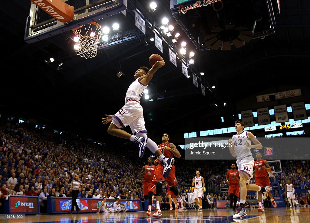 Kelly Oubre Jr #12 of the Kansas Jayhawks scores on a fast break during the game against the Texas Tech Red Raiders at Allen Fieldhouse on January 10...