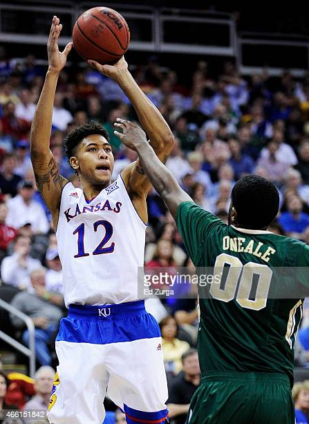 Kelly Oubre Jr #12 of the Kansas Jayhawks shoots over Royce O'Neale of the Baylor Bears in the second half during a semifinal game of the 2015 Big 12...