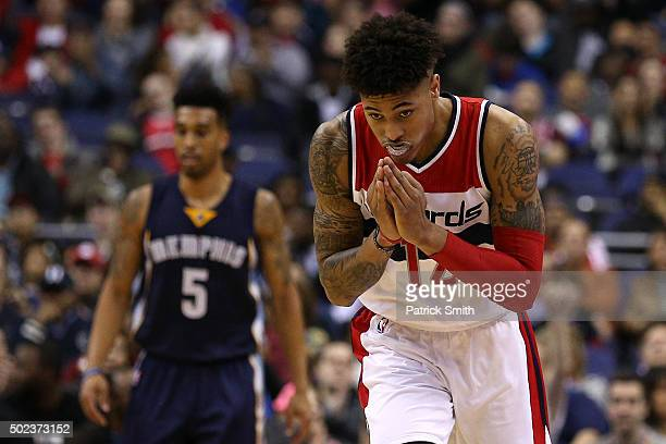 Kelly Oubre Jr #12 of the Washington Wizards celebrates a threepointer against the Memphis Grizzlies in the first half at Verizon Center on December...