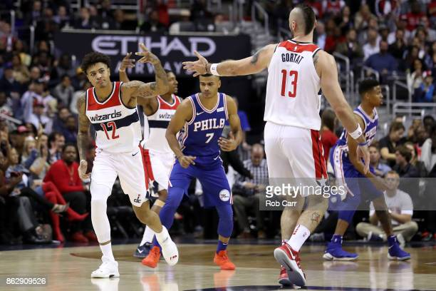 Kelly Oubre Jr #12 of the Washington Wizards celebrates after hitting a three pointer with teammate Marcin Gortat in the first half against the...