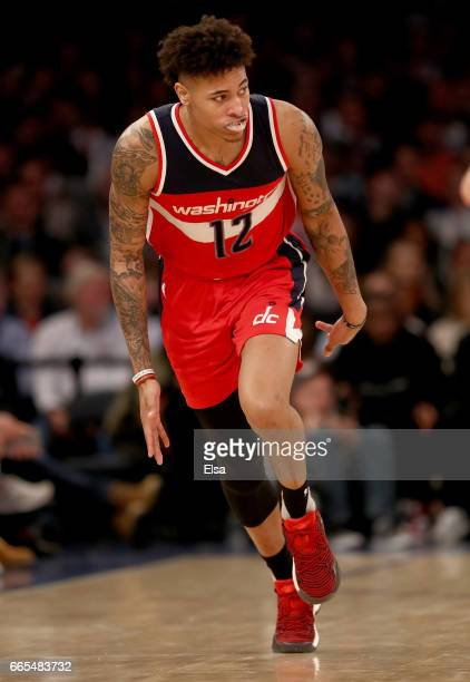 Kelly Oubre Jr #12 of the Washington Wizards celebrates his three point shot in the second half against the New York Knicks at Madison Square Garden...