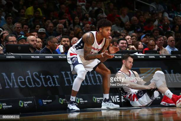 Kelly Oubre Jr #12 of the Washington Wizards cheers on his teammates during the game against the Charlotte Hornets on April 4 2017 at Verizon Center...