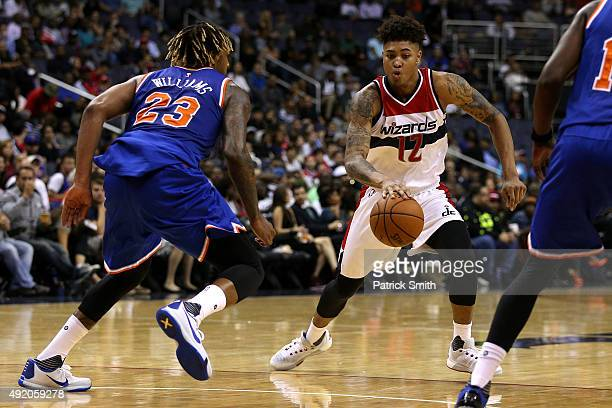 Kelly Oubre Jr #12 of the Washington Wizards dribbles in front of Derrick Williams of the New York Knicks during the second half at Verizon Center on...