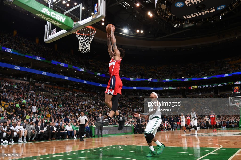 Kelly Oubre Jr. #12 of the Washington Wizards dunks against the Boston Celtics on March 20, 2017 at the TD Garden in Boston, Massachusetts.