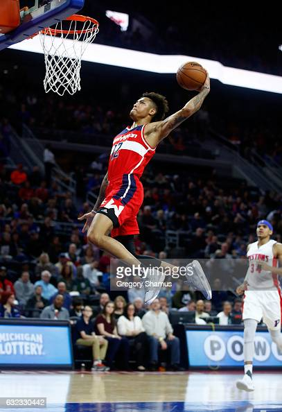 Kelly Oubre Jr #12 of the Washington Wizards gets in for a first half dunk while playing the Detroit Pistons at the Palace of Auburn Hills on January...