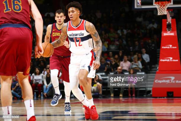 Kelly Oubre Jr #12 of the Washington Wizards handles the ball during the preseason game against the Cleveland Cavaliers on October 8 2017 at Capital...